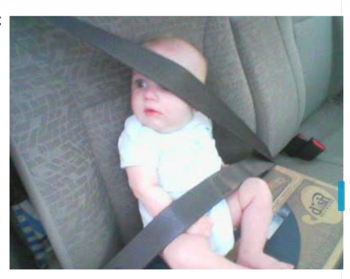 baby-in-gordel-e1567011439535 Categorie E Gebruik gordels en helmen; zitplaats voor passagiers