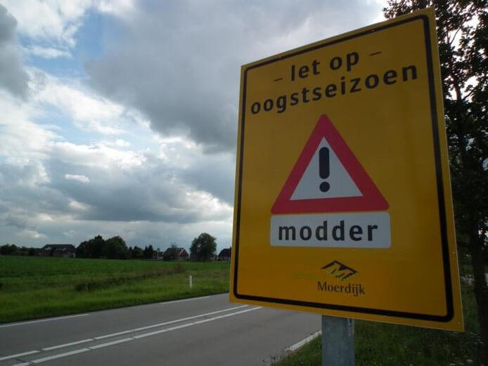 modder-op-rijbaan Categorie K Risico's in verband met weg-, zicht- en weersomstandigheden
